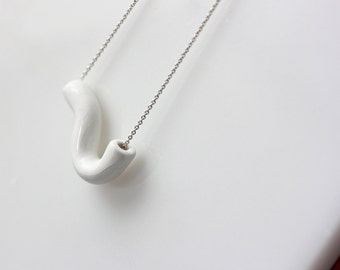 Handmade porcelain geometric necklace on a silver chain, white
