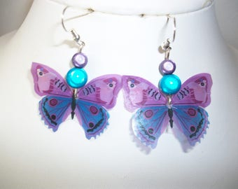 Earrings, turquoise and purple beads and butterflies.