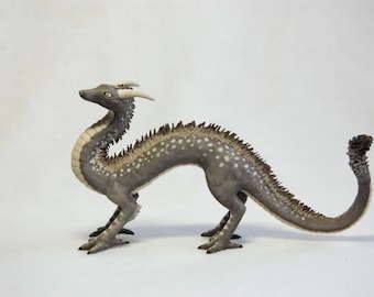 Spotted serpent dragon fantasy animal sculpture