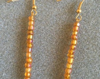 long drop gold bead earrings