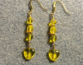Lemon yellow Czech glass heart bead dangle earrings adorned with yellow Czech glass beads.