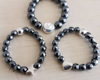 Fabulous little Stretch Rings with Facetted and smooth 3mm and 4mm Hematite, Shell, Star and Heart Rings. One Size Fits All.