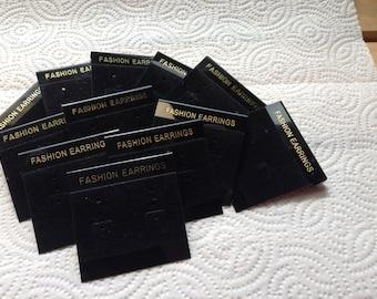 Two dozen black flocked earring cards