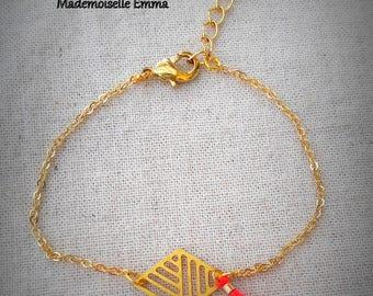 Gold metal and coral tassel bracelet