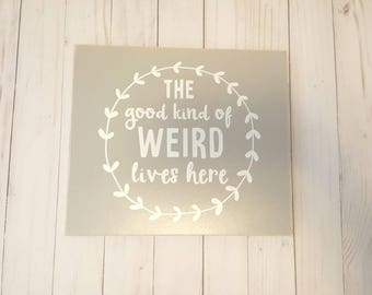 "Wood sign.  Grey - ""The good kind of weird lived here"" wall art."