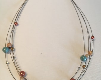 Necklace with Floating Beads
