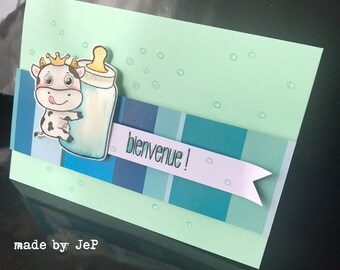 """card """"Welcome"""" baby: mini cow and her bottle."""