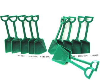 """12 Small Kelly Green Plastic Toy Shovels and 12 """"I Dig You"""" Stickers."""