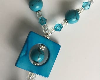 A turquoise blue necklace