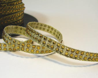 50 cm of Ribbon with gold rhinestones fusible, 7 mm.