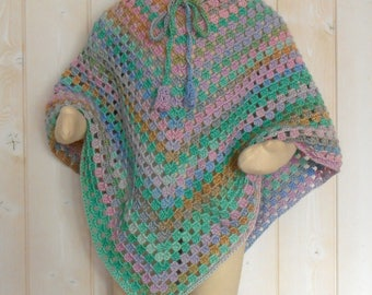 Child poncho crocheted in pastel colors