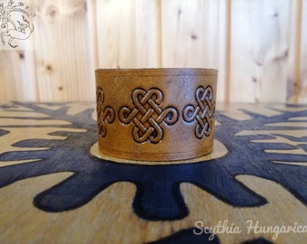 Smaller size leather bracelet with embossed endless knots
