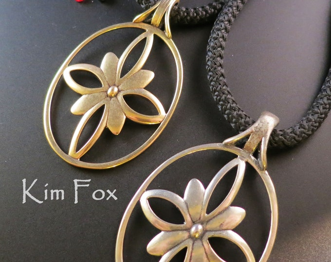 Featured listing image: Infinite Flower Pendant in Golden Bronze and Sterling Silver designed by Kim Fox