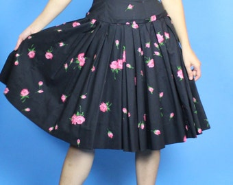 1950s. black, pink, and green, rose floral, drop waist, pleated full skirt, sleeveless dress. small