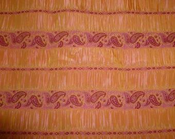 Orange fuschia smok fabric