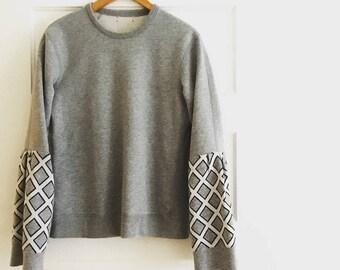 Gray sweatshirt with fabulous statement sleeves