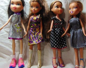 Lot of 4 Brat or My scene barbie dolls with clothes and shoes