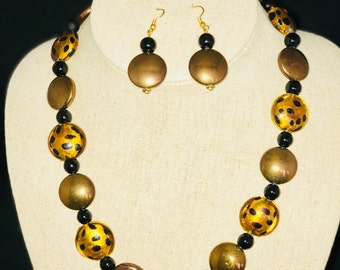AJ002 - Animal print flat disc glass beads necklace and earrings set.