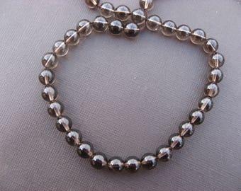 Smoky quartz: 10 round beads 8 mm.