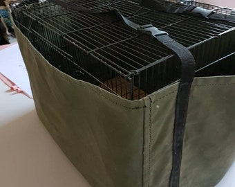 Carry bag for large bird cage in oiled canvas.