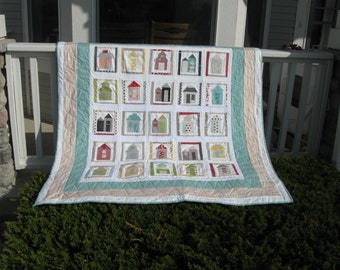 My Neighborhood  Appliqued Lap Quilt designed by Sweetwater and using Road 15 fabrics by Moda