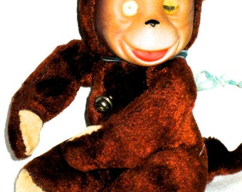 Vintage 50s monkey stuffed toy animal with lenticular eyes rubber face