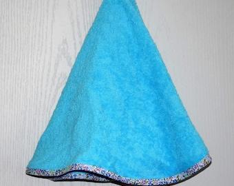 Round towel through blue flowers