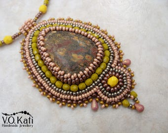 Bead embroidered pendant with leopard jasper gemstone cabochon