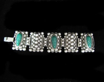 Vintage Mexican Silver Bracelet with Carved Green Faces and Bubble Pattern