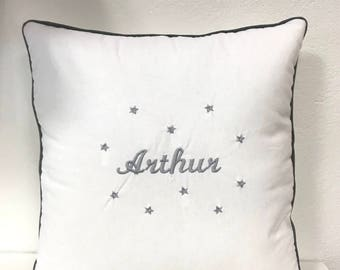 White pillow embroidered name and stars