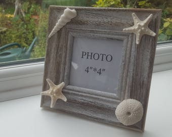 Rustic wooden photo frame with shells and starfish