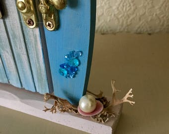 A mermaid door! To take you to an imaginary world