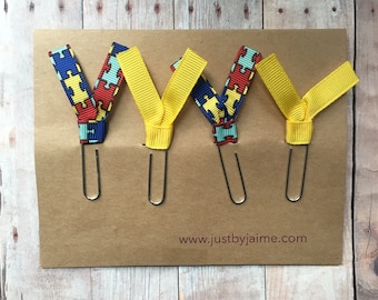 4 autism/puzzle piece themed ribbon paper clips - 2 puzzle piece & 2 yellow - gold or silver toned clip - teacher or therapist gift