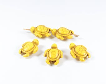 10 synthetic yellow Howlite turtle beads approximately 19 x 14 x 7.5 mm