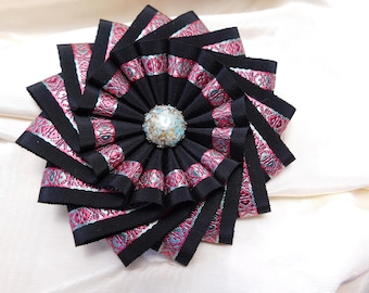 Black Pinwheel Cocarde With Pink And Aqua Accents