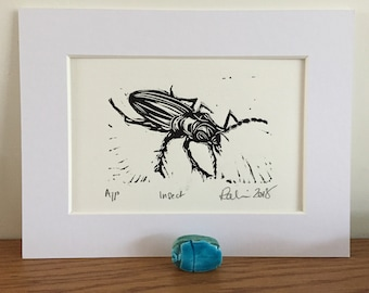 Insect - linocut print in black