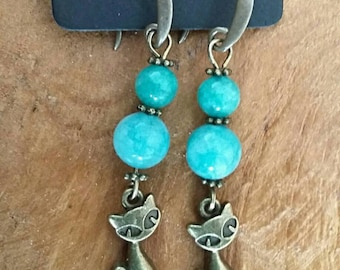 Bronze tone earring made with natural gemstones.