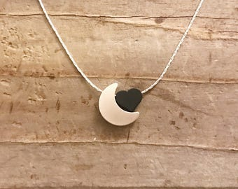 Matte silver moon and black heart necklace