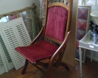 Victorian Folding Chair. Beautiful wood with intricate detail decoration. Excellent condition.