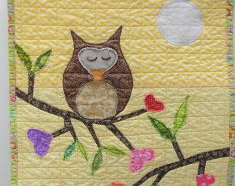 Owl quilt- appliqued wall quilt with owl, leafy branches with hearts, and full moon