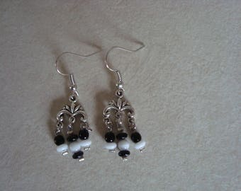 Black and white dangling earrings