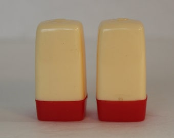 Vintage Plastic Red and Cream Salt and Pepper Shakers