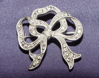 Cast Silver tone Brooch,  Ribbon bow Design, With cut Stones