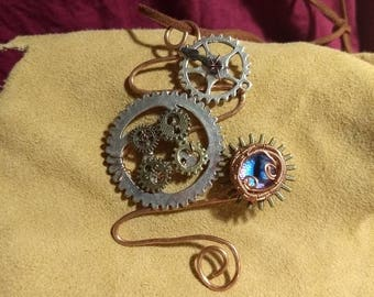Steampunk pendant with blue dragon eye in recycled copper wire