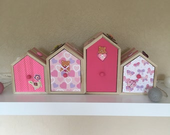 Pink wooden frame houses