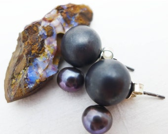 blackened silver sphere and pearl stud earrings.
