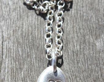 Silver heart pebble pendant, pebble pendant with embossed heart, heart pendant, silver pebble, pebble heart, rustic silver pebble charm