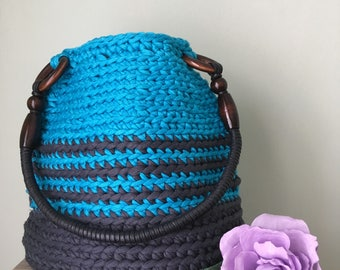 Crochet shoulder bag with cord handle.