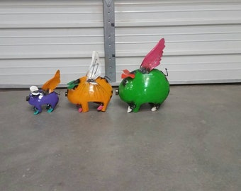 Metal flying pigs. flying pigs.rustic metal flying pigs. garden decor. colorful metal pigs. pig decor. pig art