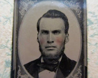 antique miniature gem tintype photo - 1800s, man with rosy cheeks, beard, stern look, floral oval frame